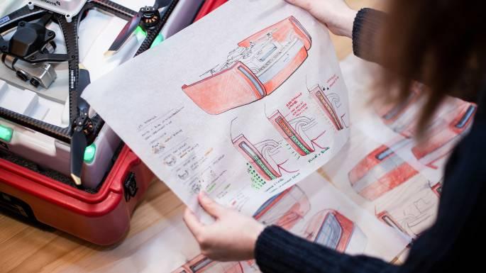 Industrial designer holding sketches of Fotokite