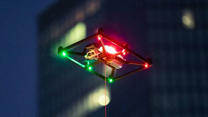 Tethered drone flying at night